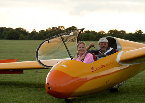 two people in a glider