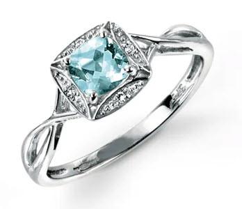 White gold aquamarine and diamond twist ring from John Greed Jewellery