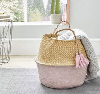 pink tassle storage basket